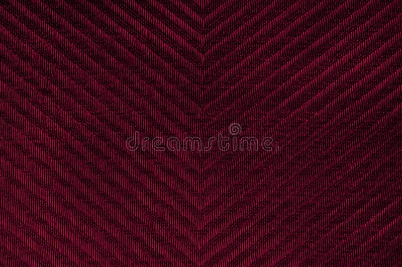 Closeup red color fabric texture. Fabric Herringbone pattern Dark Red strip line fabric pattern design sample or upholstery abstra. Ct background royalty free stock photo