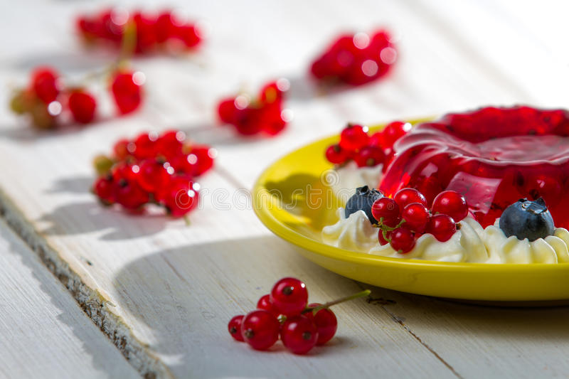 Closeup of red currant jelly with fruits stock photos