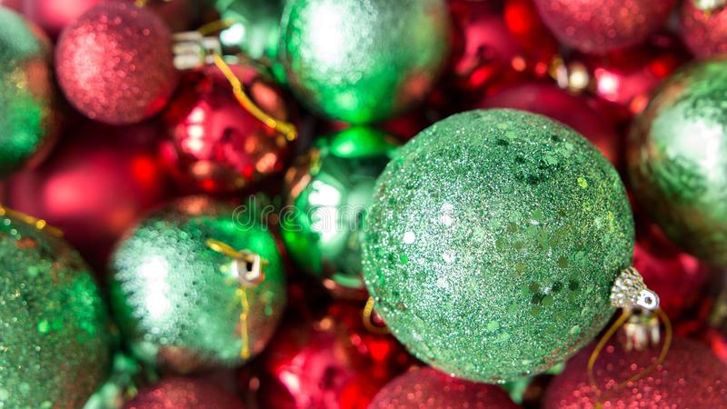 Red and green Christmas balls background stock photos