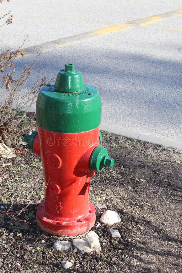 Red and green fire hydrant stock photo