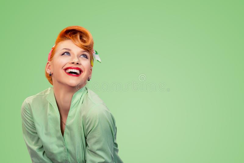 Pinup girl looking up lauging happy stock photo