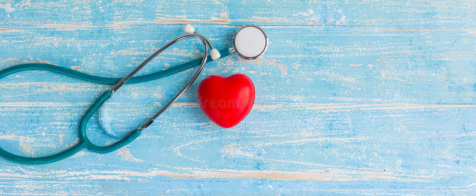 Closeup red heart and stethoscope stock images