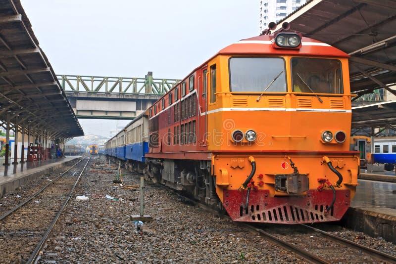 Closeup of Red orange train, Diesel locomotive. On Bangkok railway station platform Thailand stock image