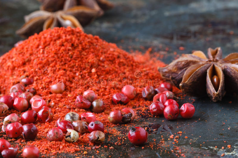 Closeup red pepper with ground paprika on dark royalty free stock image