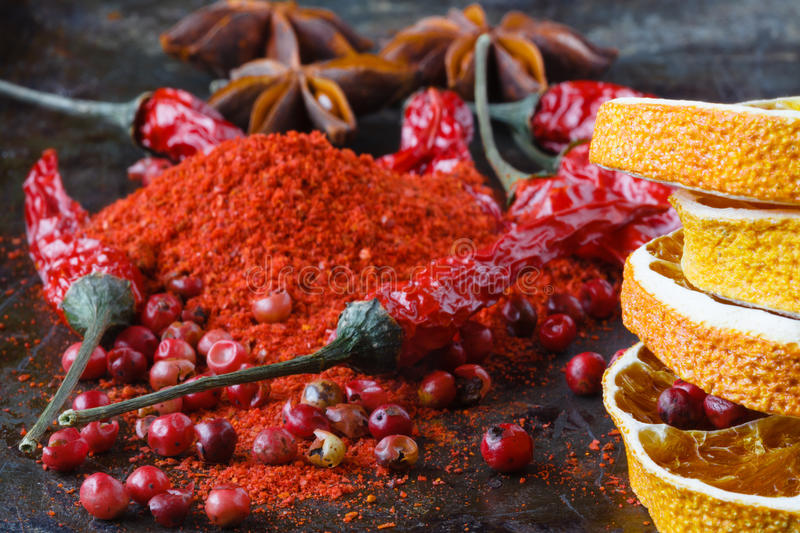 Closeup red pepper with ground paprika on dark royalty free stock photography
