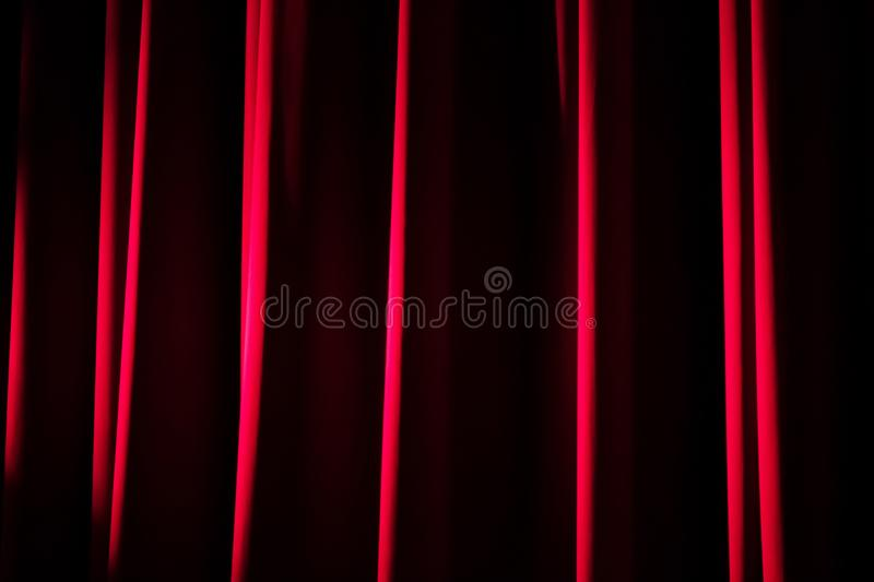 Closeup of a red velvet theater curtain. stock image
