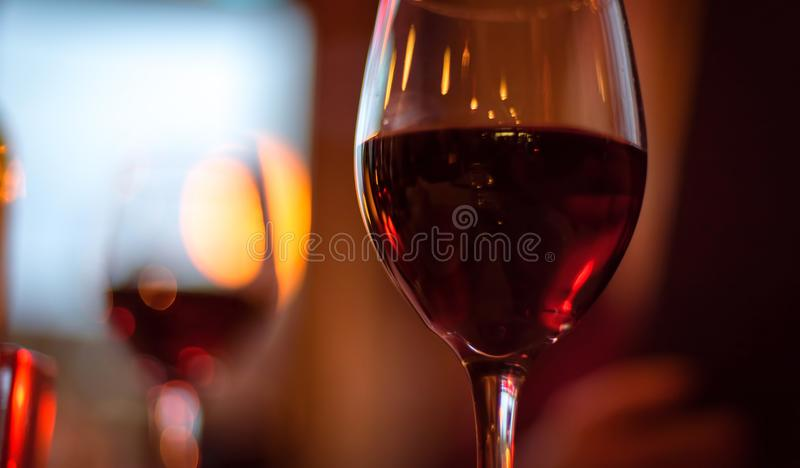Closeup of red wine glass on table. In restaurant royalty free stock photos