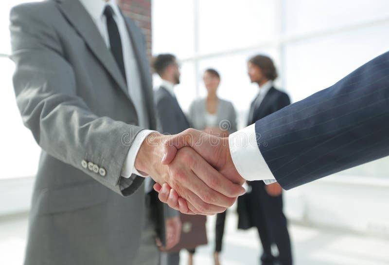 Closeup.reliable handshake of business partners stock photo