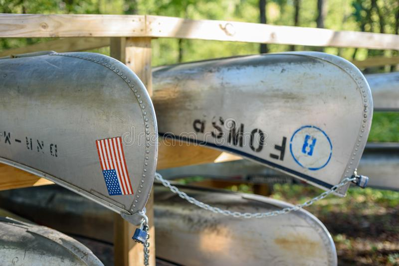 Closeup of rental canoes on rack in state park royalty free stock images