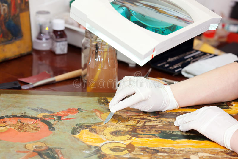 Download Closeup Of  Restorer Working On The Old Icon Stock Photo - Image: 42381884