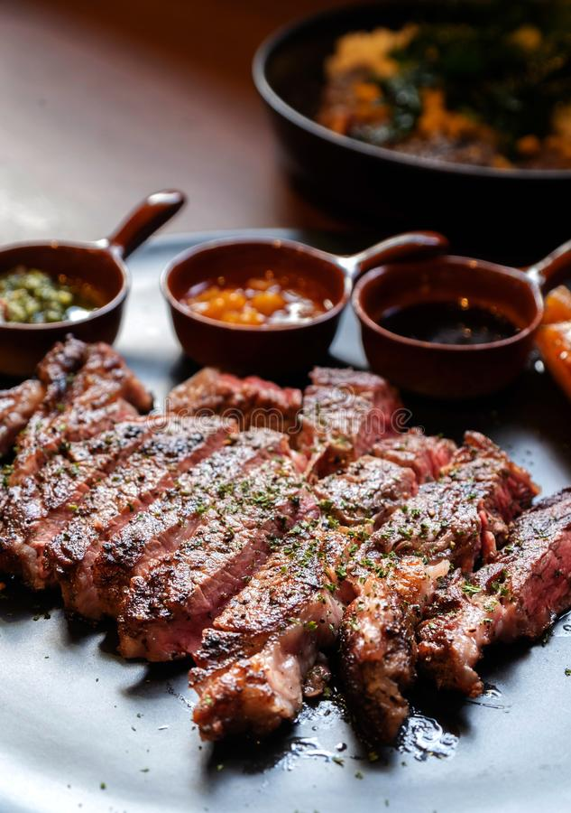 Closeup ribeye steak. Closeup medium rare ribeye steak stock photography