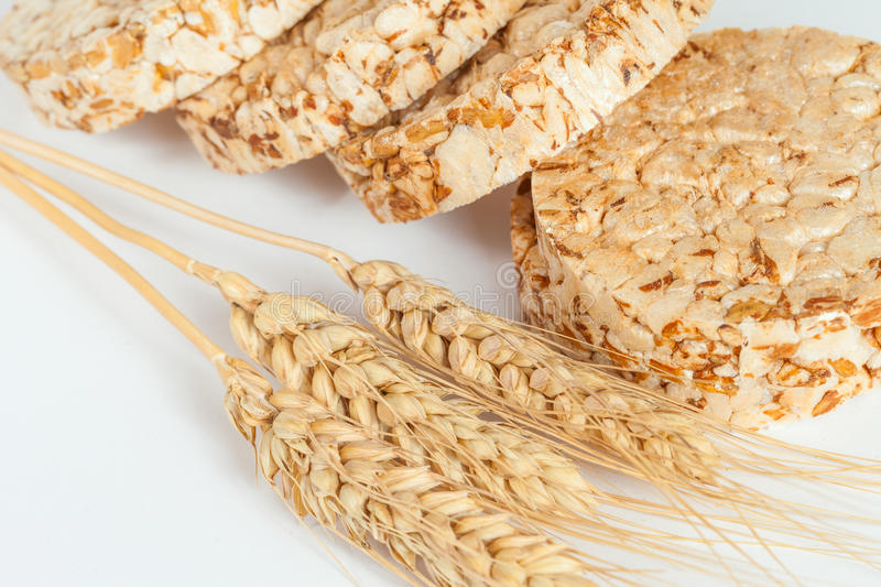 Closeup of rice cakes and wheat on white. Healthy eating concept royalty free stock photo