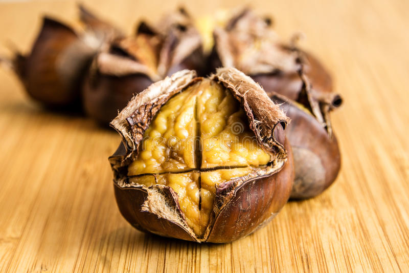 Closeup of roasted chestnuts stock image