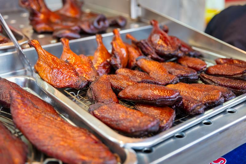 Roasted Duck At Street Market Stall. Closeup of roasted duck at street market stall in Thailand stock photos
