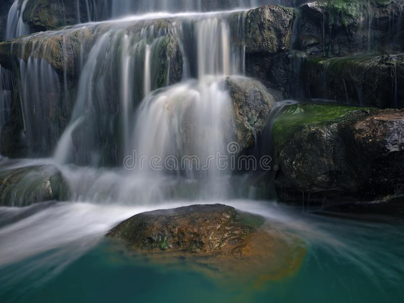 Closeup of the rocks with blurred motion of the waterfall royalty free stock image