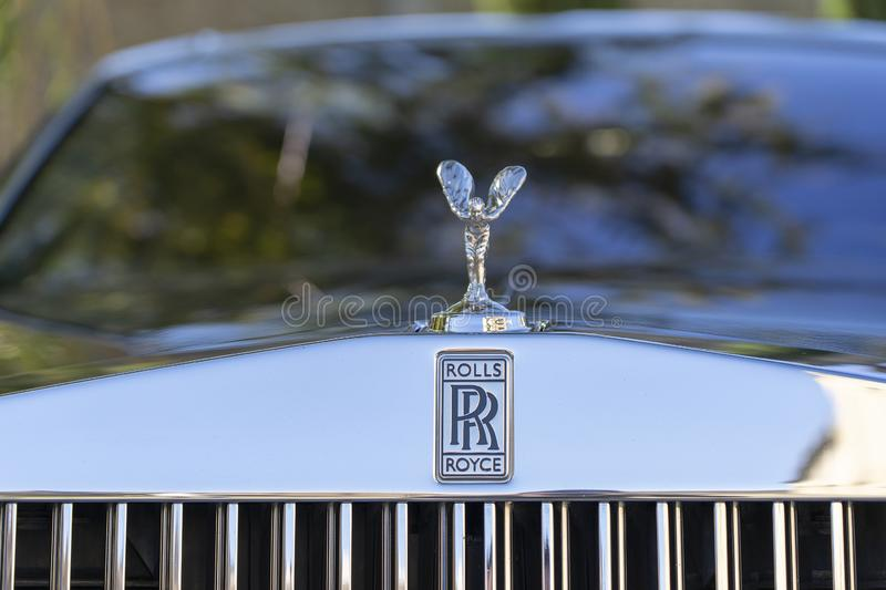 Closeup of Rolls Royce logo on car stock photography