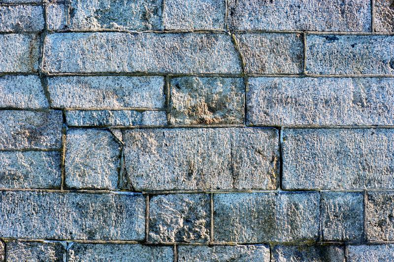 A  rough Stone block wall royalty free stock image