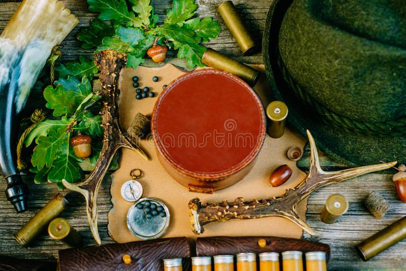 Closeup round leather hunt box for information among hunting or tourist equipment. Top view stock photography