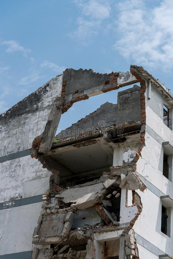 Closeup of a demolished appartment. Closeup of a ruins of a demolished appartment with blue sky and white clouds royalty free stock image