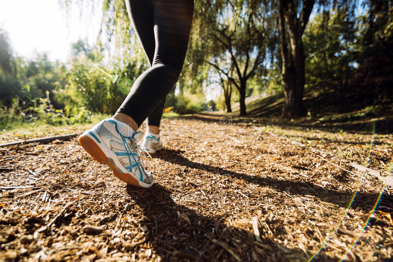 Closeup of runner feet. Jogging in nature royalty free stock photos