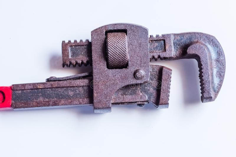 Rusted and stained Pipe Wrench handtool. Closeup of rusted pipe wrench hand tool in  background royalty free stock photos