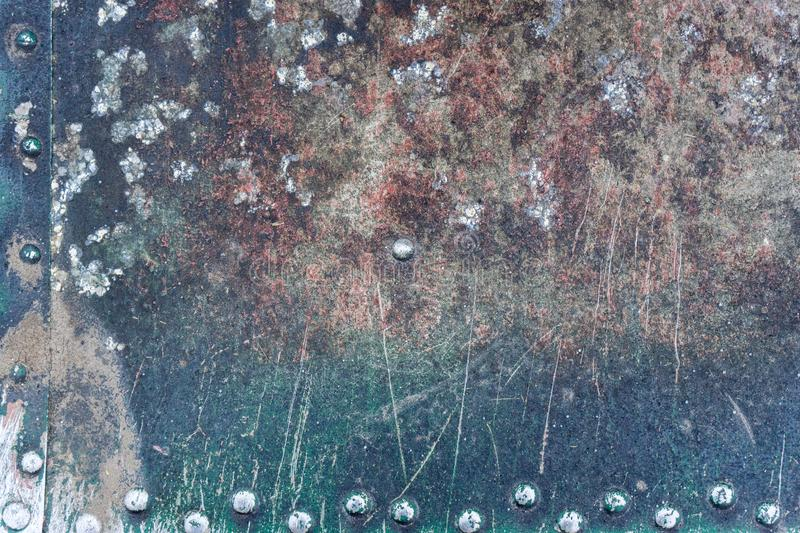 Closeup rusty colored metal, abstract grunge corroded steel background, retro vintage metallic backdrop, iron surface with shabby. Cracked paint and scratches royalty free stock images