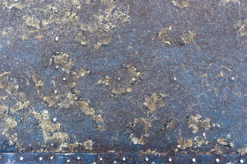 Closeup rusty colored metal, abstract grunge corroded steel background, retro vintage metallic backdrop, iron surface with shabby. Cracked paint and scratches stock image