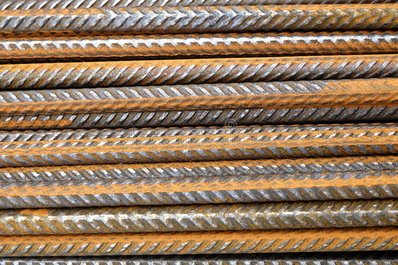 A closeup of rusty horizontally stacked steel division reinforcement bars rebar stock images