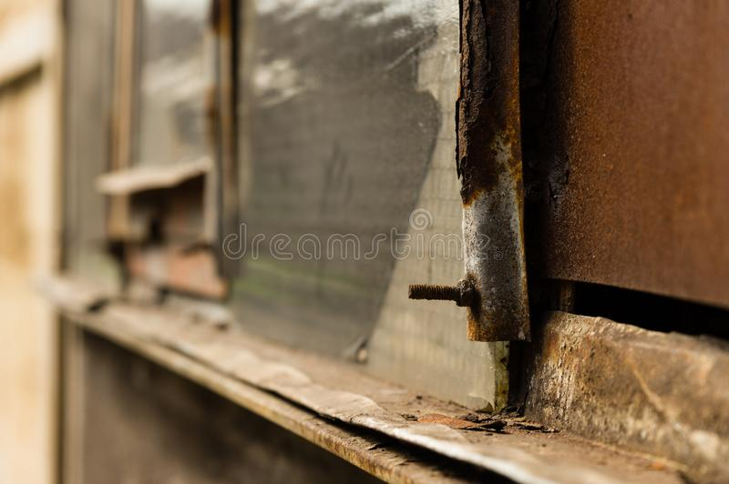 Closeup of rusty industrial building detail covered in dirt.  royalty free stock image
