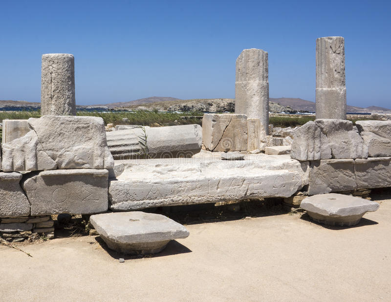 Closeup of the Sacred Way in Delos, Greece. The Sacred Way leads to the Sanctuary of Apollo. A paved road 45 feet wide, the Sacred Way is lined with marble bases royalty free stock photo