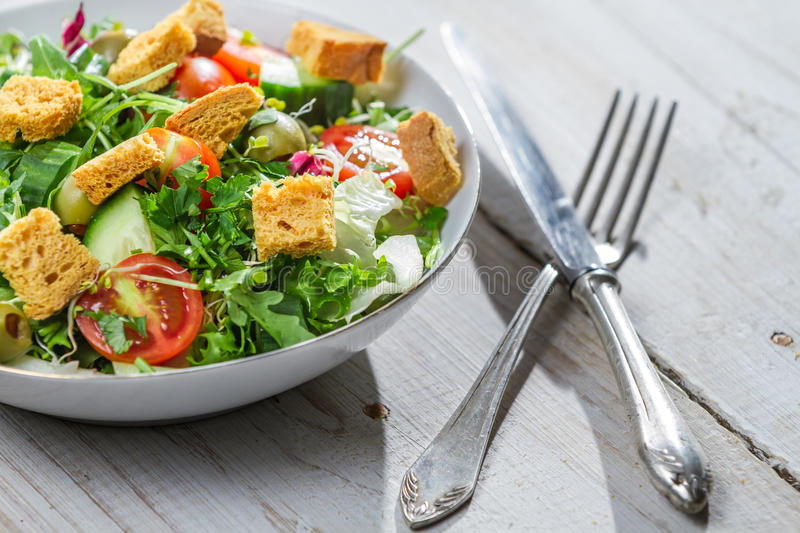 Closeup of salad with arugula and tomatoes stock image