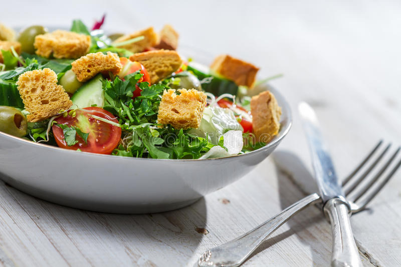 Closeup of salad with vegetables stock images