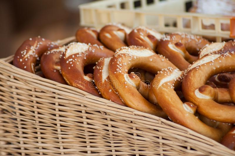 Salted pretzels  in wooden basket at the market in the street royalty free stock photos