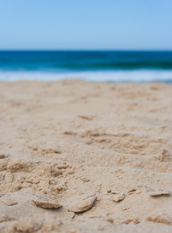 Closeup of sand at the beach on a sunny summers day. In portrait format royalty free stock photos