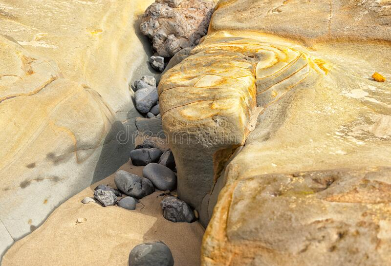 Close Up of sandstone formation and rocks at Cape Kiwanda. Close Up of sandstone formation and rocks revealed at low tide at Cape Kiwanda in Pacific City, Oregon royalty free stock images