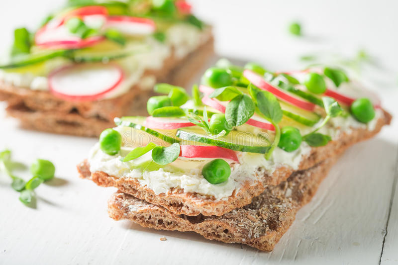 Closeup of sandwich with avocado and fromage cheese. On old white table royalty free stock photo