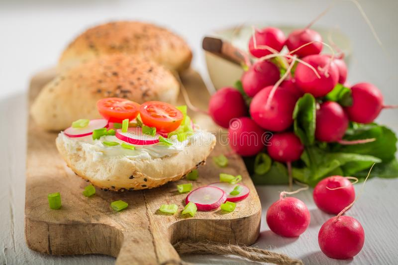 Closeup of sandwich with bread, radish and fromage cheese. On wooden table royalty free stock photo