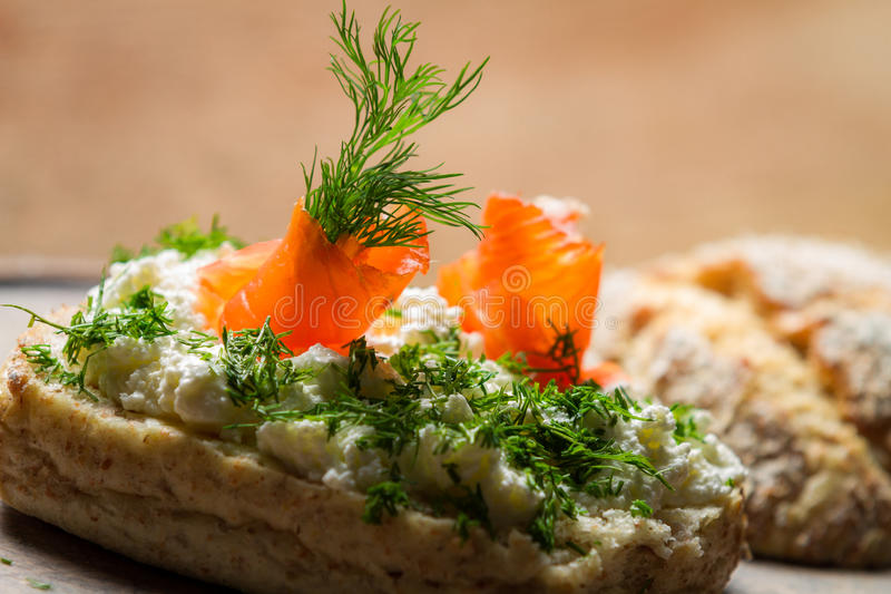 Closeup of sandwich with cottage cheese, salmon and dill stock photography