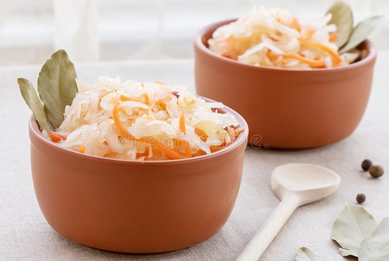 Closeup of sauerkraut with carrots in a clay bowls. royalty free stock photos