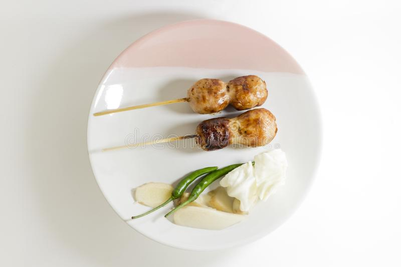 CloseUp, Sausage grill Two wooden With chilli Cabbage and ginger On a white plate stock photo