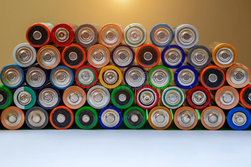 Closeup of saws of used alkaline batteries. Several in rows. Ecological pollution royalty free stock photos