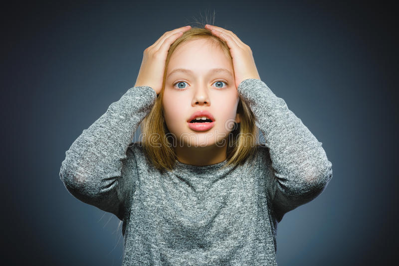 Closeup Scared and shocked little girl. Human emotion face expression stock photos