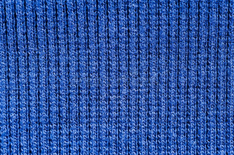 Closeup of seamless blue knitted fabric texture royalty free stock image