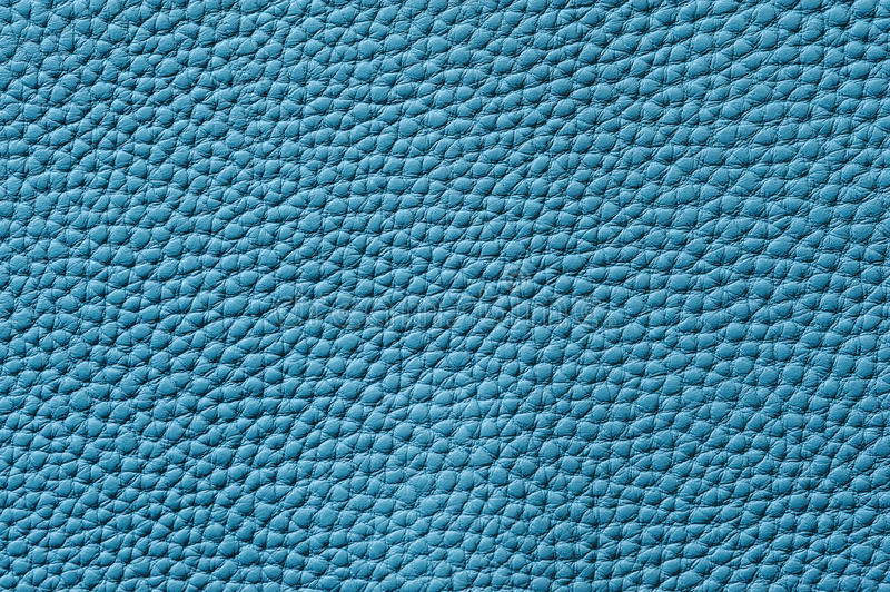 Closeup of seamless blue leather texture. For background royalty free stock images