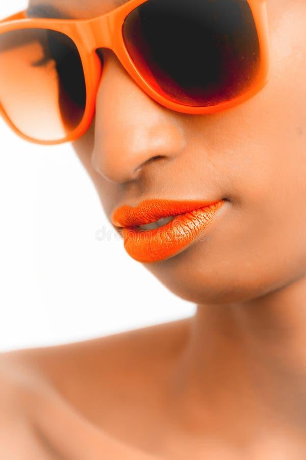 Closeup and Selective Focus Photograph of Woman Wearing Orange-framed Wayfarer-style Sunglasses stock photography