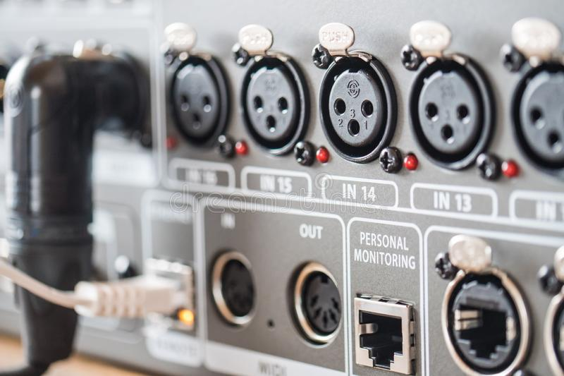 Closeup selective focus shot of professional studio audio recording equipment with input jacks. A closeup selective focus shot of professional studio audio stock photos