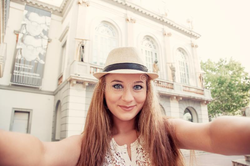 Closeup selfie-portrait of funny attractive girl tourist smiling stock images