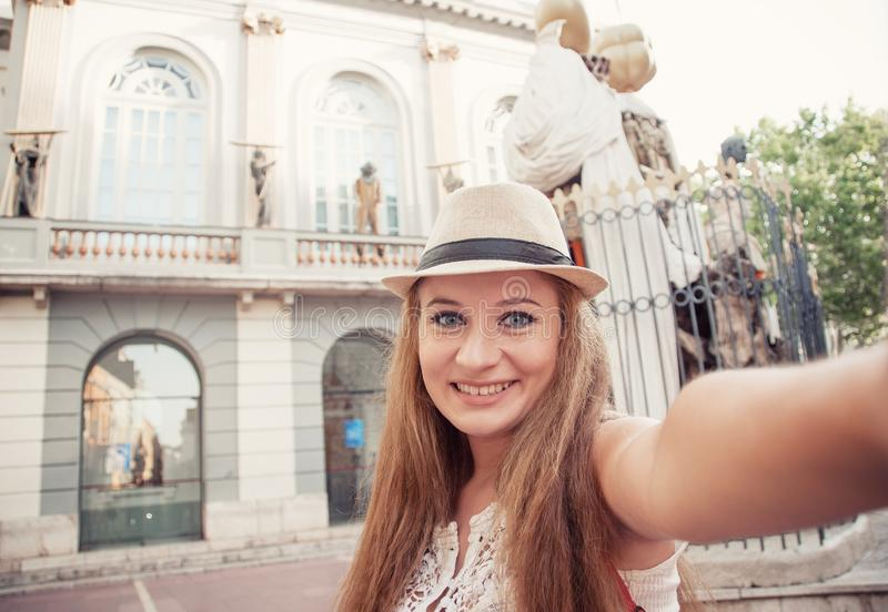 Closeup selfie-portrait of funny attractive girl tourist smiling stock image