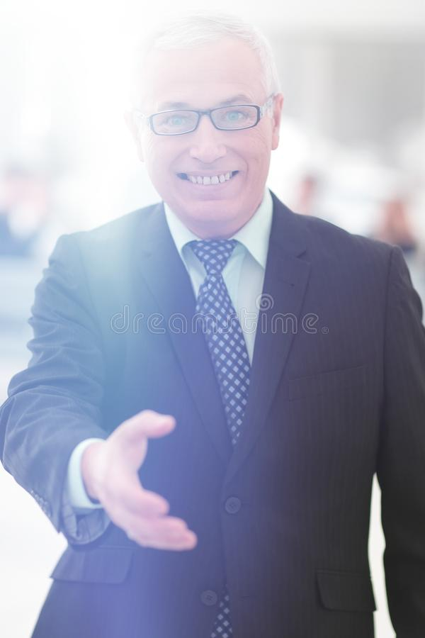Closeup of a senior businessman offering his hand for greeting. royalty free stock images