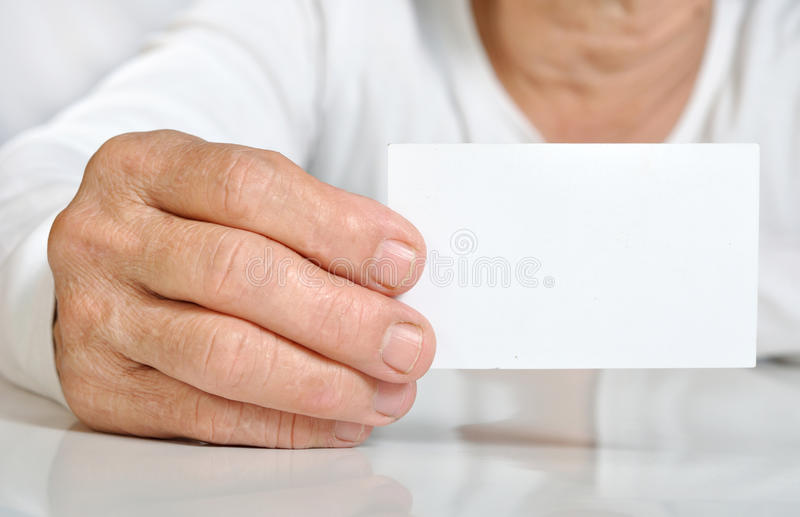 Closeup senior woman hand hold the blank card royalty free stock images